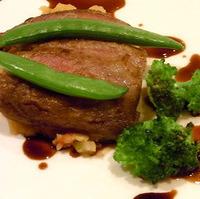 イベリコ豚のソテー、レンズ豆と温野菜の煮込み添え